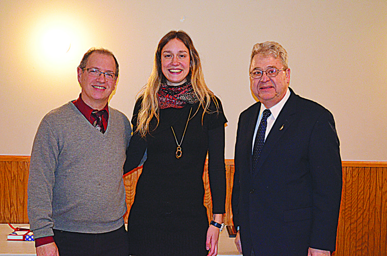 Staff photo by Connor Cummiskey  The Chair of the Sister Cities Commission Bryan Reising (left) and Mayor Bob Beussman (right) said goodbye to Hans Joohs intern Pia Brutschin (center) Tuesday evening at the Kegel Klub.