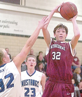 Staff photo by Steve Muscatello New Ulm Cathedral's Jon Zinniel (32) takes shot as Nick Kutz and Trent Weispfennig (23) of Buffalo Lake-Hector-Stewart look on during the first half Tuesday at CHS For more photos of this event go to cu.nujournal.com