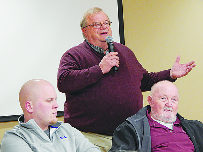 Staff photo by Fritz Busch  Friends of Fort Ridgely member Loran Kaardal of Redwood Falls, back, makes at point at the Friends of Fort Ridgely rally Thursday night at Fairfax. Listening in front from left are Fairfax Mayor Greg Johnson and Friends member John Fritsche of New Ulm.