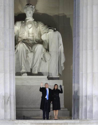 "President-elect Donald Trump and his wife Melania Trump wave at a pre-Inaugural ""Make America Great Again! Welcome Celebration"" at the Lincoln Memorial in Washington, Thursday, Jan. 19, 2017. (AP Photo/David J. Phillip)"