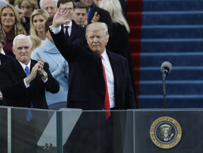 Vice President Mike Pence, left, applauds as President Donald Trump waves after delivering his inaugural address after being sworn in as the 45th president of the United States during the 58th Presidential Inauguration at the U.S. Capitol in Washington, Friday, Jan. 20, 2017. (AP Photo/Patrick Semansky)