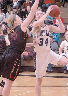 Journal File photo Cedar Mountain/Comfrey's Paige Richert competes in a game against Sleepy Eye High School. Richert surpassed 1,000 career points in a loss to Gibbon-Fairfax-Winthrop on Friday.
