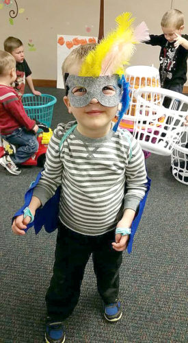 Photo submitted by Hannah Scharf. Charles Schaefer dressed up like a bird while playing with other children during one of the MUMS meetings in the basement St. Paul's Lutheran Church.