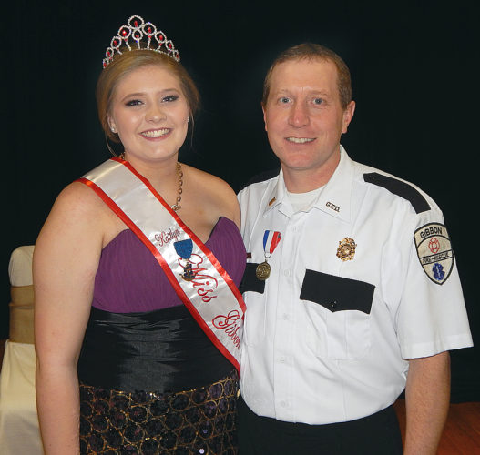 Kaitlyn Unger, left, was crowned 2017 Miss Gibbon at GFW Elementary School Saturday night. At right is Gibbon Fire Department Captain Jason Rettig, who received the Minneapolis Aquatennial Honorary Commodore's Award for community volunteerism. Aquatennial officials also gave medals to all Gibbon Fire and Rescue personnel.