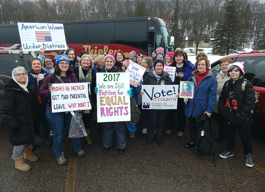 Staff photo by Fritz Busch About 60 women and a few men return to New Ulm from the Women's March Minnesota in St. Paul late Saturday afternoon. The group that rode a bus to the Twin Cities and back included people from New Ulm, Sleepy Eye, Springfield, St. Peter and Mankato. They were part of a national surge of marches inspired by the rhetoric of the last election they said insulted, demonized, and threatened them. St. Paul police estimate around 60,000 people participated in the march.