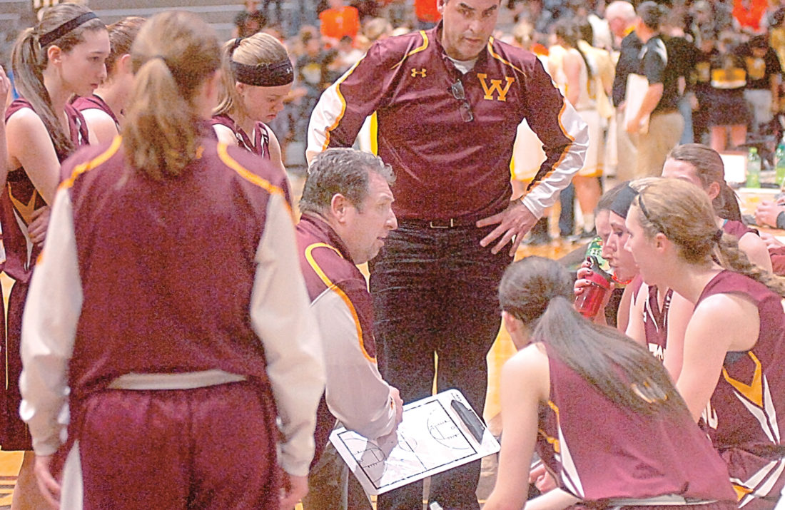 Journal file photo. Wabasso head coach Neil Dolan (center with         clipboard) speaks to his team during a timeout at a section 3A Championship game at Southwest State University in  Marshall.