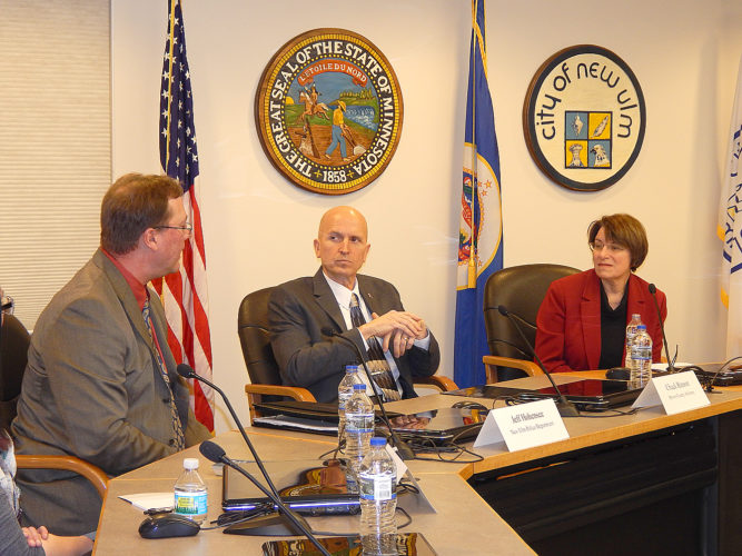 Staff photo by Fritz Busch Above, New Ulm Police Senior Investigator Jeff Hohensee, left, shares some information with Brown County Attorney Chuck Hanson and U.S. Sen. Amy Klobuchar in a roundtable on human trafficking at New Ulm City Hall Saturday.
