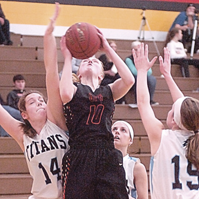 Staff photo by Steve Muscatello Gibbon-Fairfax-Winthrop's Halley Busse takes a shot between three Tri-City United defenders Saturday in Winthrop. Busse surpassed 3,000 career points in the second half of the game. For more photos of this event go to cu.nujournal.com