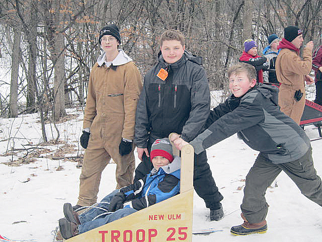 Boy Scouts from New Ulm Boy Scout Troop 25 (now sponsored by the New Ulm Optimist Club) were at the Norseland Scout Camp Saturday, Feb. 4 at the annual Klondike Derby. Pictured are scouts from the troop preparing for the race. In the sled is Jackson Holm. Others, from left, are Jacob Vogel, Bennet Carlson and Brandon Hoffmann.