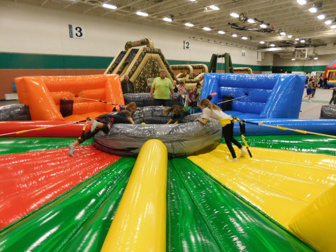 The Hungry Hungry Hippo inflatable was new to this year's Winter Blast Day of Play held Monday at Vogel Fieldhouse. Four kids are tied into a life-size Hungry Hungry Hippo game and compete to collect the most foam balls. Staff photos by Clay Schuldt