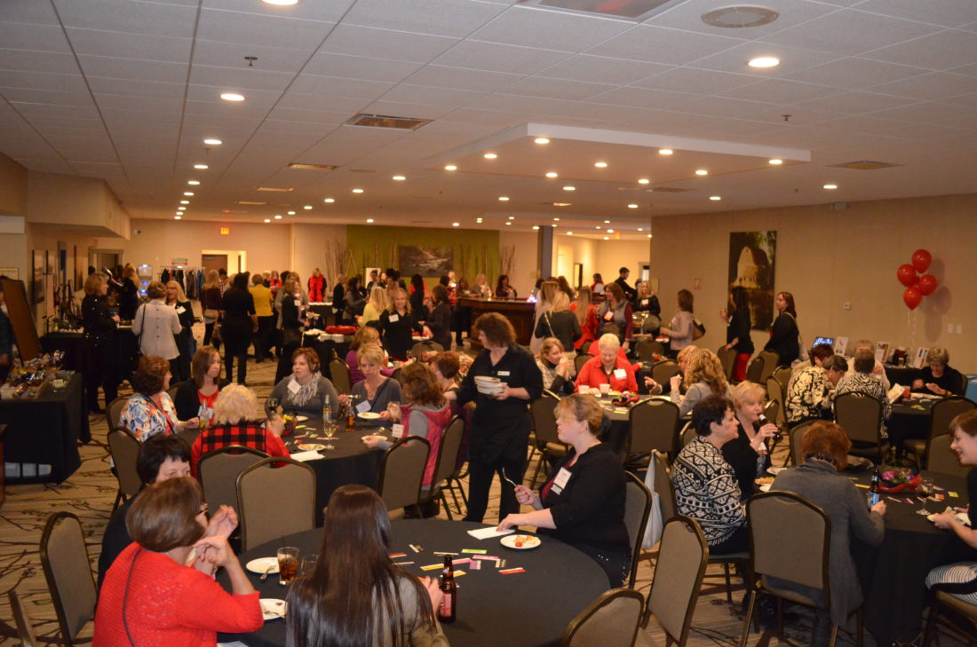 "The Best Western Plus conference center was filled with women chatting, eating and having fun during the ""Mingle with a Purpose: Heels and All"" networking event for women.  Staff photos by Connor Cummiskey"