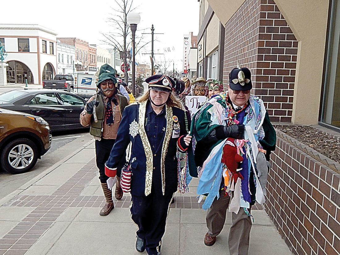 Staff photo by Fritz Busch New Ulm Mayor Bob Beussman is led down Minnesota Street in his traditional Fasching rags, accompanied by the New Ulm Narren, to declare the opening of the Fasching celebration in New Ulm. The German-style Mardi Gras will be held at the Best Western Plus in New Ulm, from 1 to 7 p.m. See more photos on page 10B.