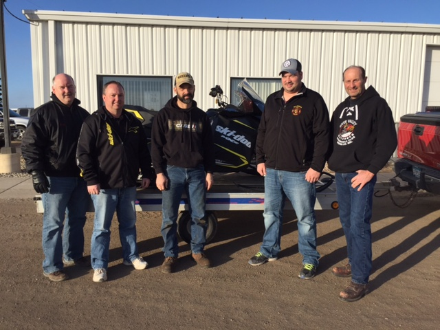 The River Valley Dutchmen Snowmobile Club held two raffles on Feb. 4. The first grand prize winner of a 2017 Ski-Doo snowmobile, purchased from Miller-Sellner, was Andrew Johnson of Hanska. Second through eighth place winners of $50 each were Jerry Lamecker of New Ulm, Nick Braulick of Sleepy Eye, Dave Dalueg of Essig, Alvin Krzmarzick of Sleepy Eye, Mike Carr of Sleepy Eye, Alan Woelfel of Morgan, and Andrew Clemenson of Zumbrota. In the second raffle, winner of  an Arctic Cat ZR120 youth snowmobile was Wardell Lueck of New Ulm. Pictured above with the grand prize in the first raffle are from left: Doug Miller of Miller-Sellner; Leon Krzmarzick, Ski-Doo salesman at Miller Sellner; Mike Fischer, raffle chair for the River Valley Dutchmen; Andrew Johnson, winner of the snowmobile, and Gary Kuelbs, president of the River Valley Dutchmen Snowmobile Club.