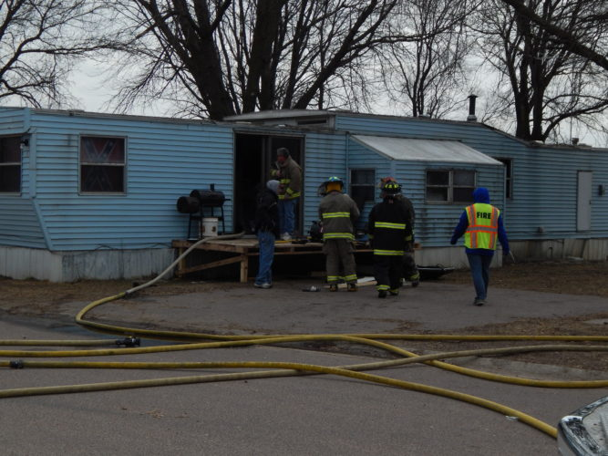 New Ulm firefighters outside the trailer at Skyview Trailer Park.
