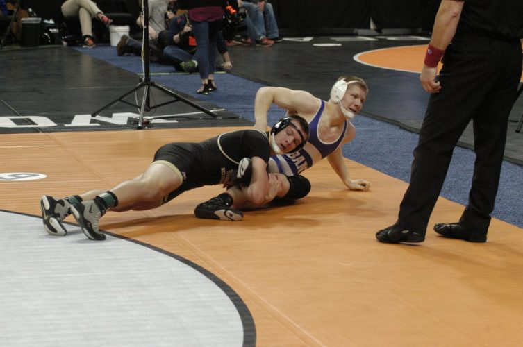 File photo by Jake Calhoun Wabasso/RRC's Mitchell Fulton makes sure he keeps his feet in the ring to secure the takedown of Albany's Gabe Zierden in the Class AA 182-pound state wrestling tournament. Fulton lost a close match and was denied a spot in the wrestlebacks.