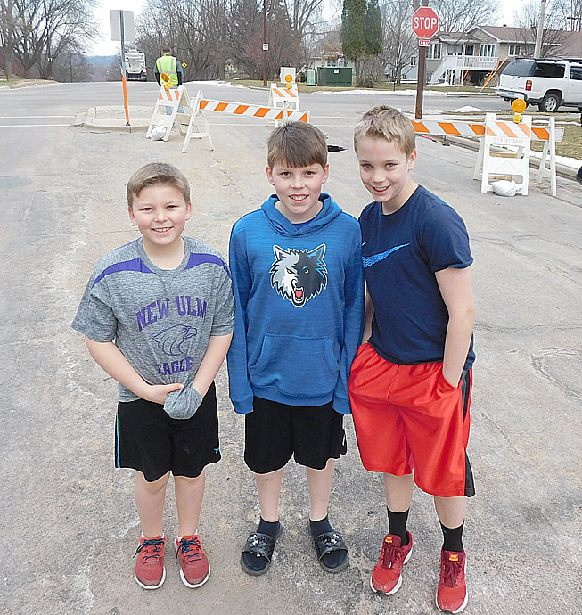 (Left to right) Charlie Weidman, Will Weidman and Rhett Melby stand by the sinkhole they discover Saturday afternoon. The three boys blocked traffic from the hole until police arrived.