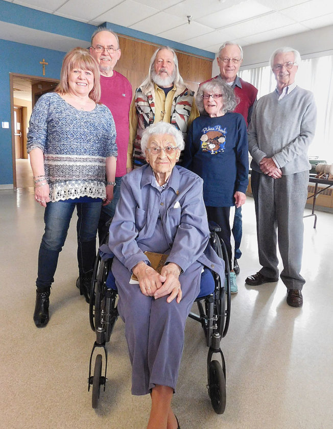 Staff photo by Clay Schuldt German Club members (L to R) Angela Jahr, Klaus Jahr, Henk Exoo, Linda Meidl, Roy Joel and George Glotzbach stand behind 101-year-old Veronica Johanneck. Johanneck's grandparents were fluent in German and she remembers some of the language, but admitted the club members were more knowledgeable about speaking the language. The meeting in Sleepy Eye allowed her to hear the language again.