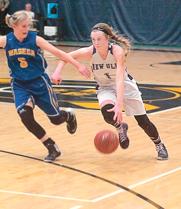 File photo by Steve Muscatello New Ulm's Meleah Reinhart drives in a game against Waseca. Reinhart was named the 2017 All-Journal Girls' Basketball Player of the Year.