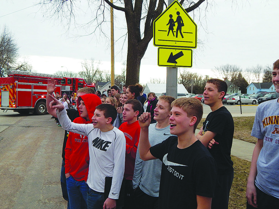 Springfield Public School students cheer as the Tigers are escorted out of town by Springfield Police and Fire Departments Wednesday.