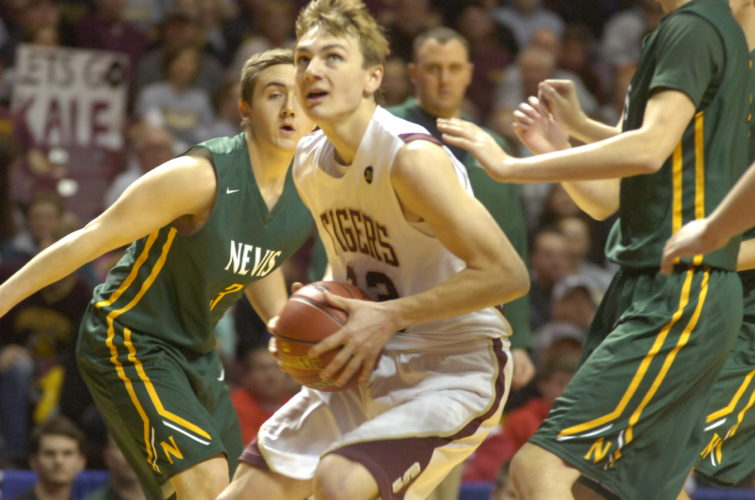 Staff photo by Jeremy Behnke Springfield's Isaac Fink dribbles between Nevis defenders in Springfield's Class A state boys' basketball quarterfinals win on Thursday at Williams Arena. Fink had 20 points, 10 rebounds and six assists.