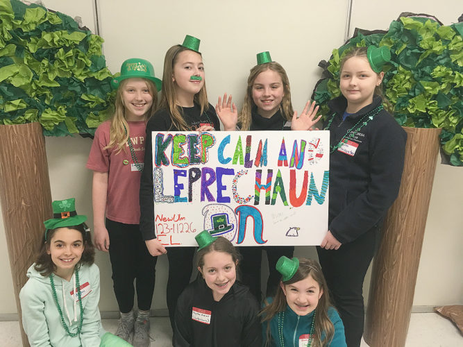 Team Keep Calm and Leprechaun On, 5th graders from New Ulm Middle School, took first place Saturday in the Northern Regional Destination Imagination tournament at Blaine High School and will be competing in the state tournament in April. They were one of 18 teams competing at the Elementary Level in the Vanished! Fine Arts challenge. In front, (L-R) are Megan Hames, Peyton Kveno and Emmie Stangel. In back (L-R) Abigail Rathmann, Alex Groebner, Isabelle Fuhr, Alyssa Rainwater The Destination Imagination program is a fun, hands-on system of learning that fosters students' creativity, courage and curiosity through open-ended academic challenges in the fields of STEM (science, technology, engineering and mathematics), fine arts and service learning. Participants learn patience, flexibility, persistence, ethics, respect for others and their ideas, and the collaborative problem solving process.