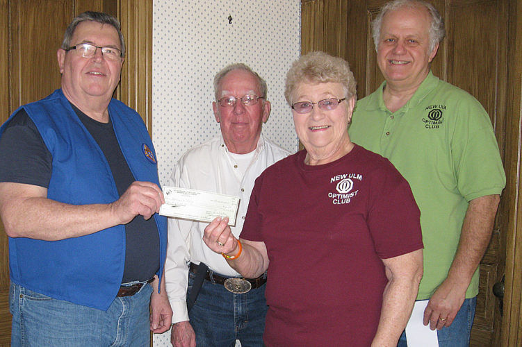 """Submitted photo Dar Schmidt (second from right), along with fellow Optimist Club members Jim Schmidt (center) and Terry Sveine (right), accepts a donation for $500 from Don Hellendrung, representing the Knights of Columbus  Council 1076. The donation is to help with the transition of the sponsorship of Boy Scout Troop 25 from the Knights to the Optimists."""""""