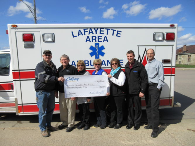 """Submitted photo Citizens Bank Minnesota 'Jeans for Change' recently donated $350.00 to the Lafayette Area Ambulance. Jeans for Change was started in March of 2017 with the idea that all bank employees can donate $5 to wear jeans on the first Friday of each month. The proceeds are then given to area non-profits. In April the money raised went towards the Stryker hydraulic-powered ambulance cot. Mark Dick, President of the Lafayette Area Ambulance, stated """"The cot can support 650 pounds and be loaded by one person into the back of the ambulance."""" Pictured from left to right: Mark Dick, President of the Lafayette Area Ambulance, Kevin Yager, Sheri Portner, Lori Dick, Laura Isaacson, Nick Peterson and Robert Wise of Citizens Bank Minnesota, Lafayette Branch."""