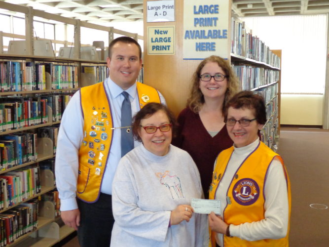 Submitted photo New Ulm Lions donate to Library  The Lions Club of New Ulm recently donated $1000 to the New Ulm Public Library. These funds will be used to purchase Large Print Books. This donation was made possible by the excellent attendance at our recent March 5th Dad's Belgian Waffle Brunch fund raiser where we served over 700 guest. Pictured L - R, back row; Waffle Brunch Co-Chair, Lion Jason Engstrom and Kris Wiley, Library Director. Front row; Betty Roiger, Acquisitions; accepting the $1000 check from Waffle Brunch Co-Chair, Lion Diann Warta.The Lions also support the Low Vision Project at the New Ulm Public Library. Various devices and magnifiers are available for loan to anyone who is having difficulty reading and doing everyday chores due to diminished eyesight. For more information, contact Monica Buboltz at 354-5680 or contact the library at 359-8331.