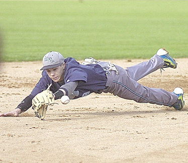Staff photo by Steve Muscatello Minnesota Valley Lutheran shortstop Alec Gratz dives for the ball during the Chargers' game against Wabasso Thursday at Mueller Park in New Ulm.  For more photos of this event go to cu.nujournal.com