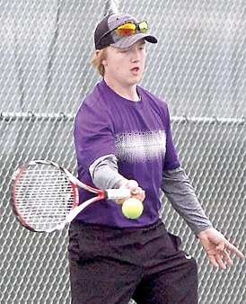 Staff photo by Steve Muscatello New Ulm's Andrew Goodall returns a volley during No.2 singles play Thursday against St. Peter.  For more photos of this event go to cu.nujournal.com
