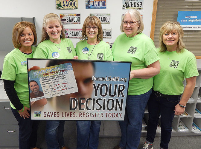 Staff photo by Fritz Busch Brown County License Bureau staff wear their green Donate Life shirts at work Friday in an effort to bring awareness to the need for organ, eye, and tissue donation. Pictured from left, Suzanne Jensen, Annette Olson, Robbi Koons, Chris Benzing and Nancy Renner. For more information,visit https://www.life.source.org/