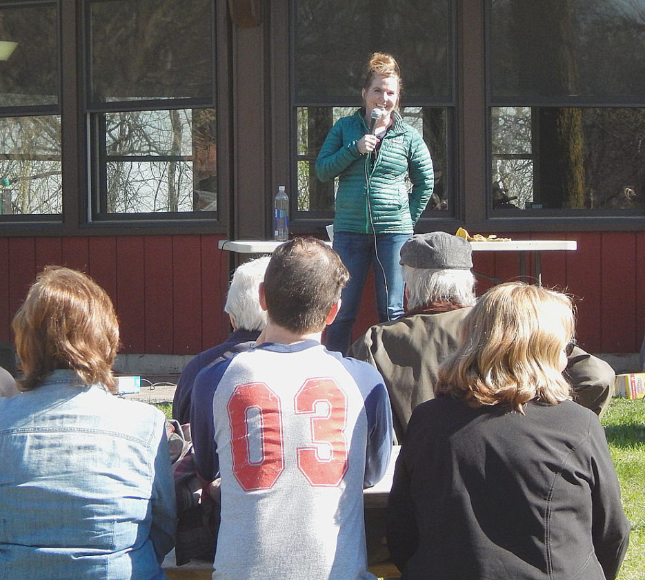 Staff photo by Kevin Sweeney Megan Benage, one of the speakers at the March for Science, talks to an appreciative crowd at Hermann Heights Park during the March for Science event in New Ulm Saturday.