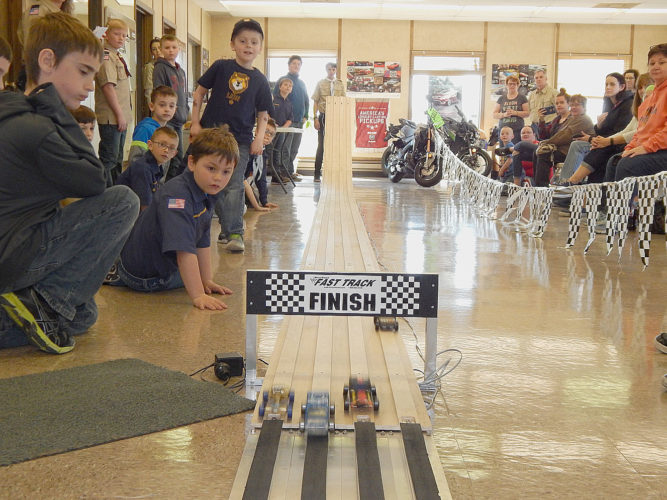 Cub Scouts from the Western Prairie region of the Twin Valley Boy Scout Council competed in their Pinewood Derby competition  Saturday at Maday Motors in New Ulm. At right, Scouts watch a close finish in one of the heats. The winners were 1st: Tyler Oswald, Pack 51, New Ulm; 2nd: Dylan Portner, Pack 51, New Ulm, and 3rd: D.J. Perrizo of Pack 10 in Windom. A total of 17 Cub Scouts from around the region competed