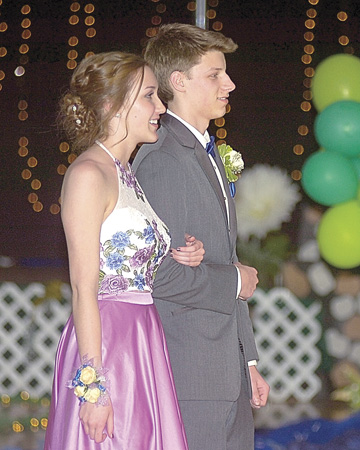 Liza Dittrich escorted by Andrew McCain.