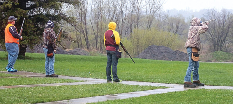 A team of shooters takes turns shooting at clay targets at the Sioux Valley Gun Club in New Ulm.