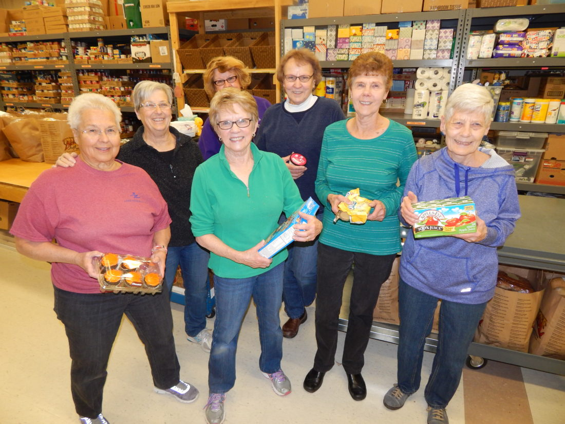 Staff photo by Fritz Busch  New Ulm Area Emergency Food Shelf volunteers, front row, from left, Carol Muller, Sue Liesch, Charlotte Fischer and Mary Lou Fenske. Back row, Judy Besemer, Helen Vogel and Jannine Harmening.