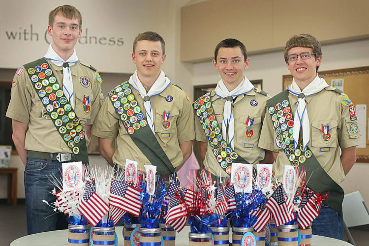 Submitted photo  Four local Boy Scouts received their Eagle Scout awards, the highest achievement in Boy Scouts, on Sunday, April 23, at Our Savior's Lutheran Church in New Ulm. (From left)  Andrew Blumhoefer, Dan Lindquist, Tony Rosenhamer and Kelby Stocker, all New Ulm High School seniors, have been with Troop 25 since first grade. They each received their Arrow of Light when crossing over from the Cub Scout Pack 51 to Boy Scout Troop 25 in 2010. Each scout chose a different project to enhance their community. Blumhoefer built five Little Free Libraries and installed them in various parks in New Ulm. Lindquist repainted and repaired the siding of the Izaak Walton League Lodge at the Brown County Fairgrounds. Rosenhamer planted a pollinator garden as well as installed 12 raised garden beds for the Washington Learning Center. Stocker installed agility equipment and added shade material for the dogs at the local dog park.