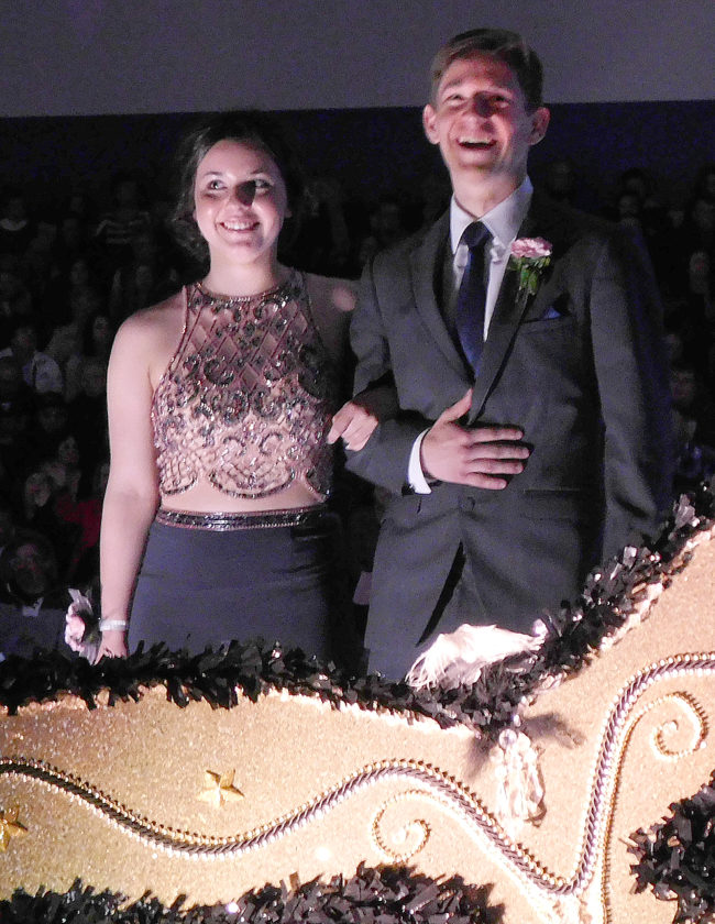 Carly Johnson is escorted by Jacob Beranek at the NUHS prom.