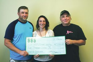 Submitted Photo Olivia's 5K Wish Run Fund, a fund of the Northern Chautauqua Community Foundation (NCCF), received a generous donation of $5,000 from the 2016 Shoot for Olivia's Wish fundraiser.  The event took place at the Hanover Fish and Game Club on Sunday, Sept. 4. A special thank you to organizers Ken Drozdziel and Samantha Vacanti who presented the $5,000 check to David Coia to support Olivia's 5K Wish Run's efforts to promote awareness and research for Triple Negative Breast as well as scholarships for local high school students.  Shoot for Olivia's Wish brought in 53 shooters to the 100 Target Sporting Clays Registered event held in Forestville. Shooters came from not only several states but also Canada. Drozdziel also thanks all the sponsors who helped make this year's event a success and to everyone who participated in the Chinese Auction and Buffalo Bills Ticket Raffle. Visit the event's Facebook page, facebook.com/shootforoliviaswish, for a complete list of shoot results and event station sponsors. Pictured from left are Ken Drozdziel, Samantha Vacanti, as they present the Shoot for Olivia's Wish $5,000 check to David Coia, right, of Olivia's 5K Wish.