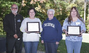 """Submitted Photo Julie Sticek (second from left), who received the Barbara Saletta Meritorious Service Award, and Diana Beckwith (right), recipient of the Poummit Secretarial Award, are joined by Ron """"Ace"""" Everett and Sue Engberg, brother and sister of Ms. Saletta."""