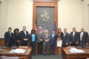 Submitted Photo Pictured from left: Legislator Peter Savage, Legislator Barbara Miller Williams, Legislator Patrick Burke, Legislator Betty Jean Grant, Minority Leader Thomas  Loughran, Chairman John Mills, Majority Leader Joseph Lorigo, Legislator Lynne Dixon, Legislator Edward Rath, Legislator Kevin Hardwick and Legislator Ted Morton with their Paper Reduction Contest trophy, a golden copy machine