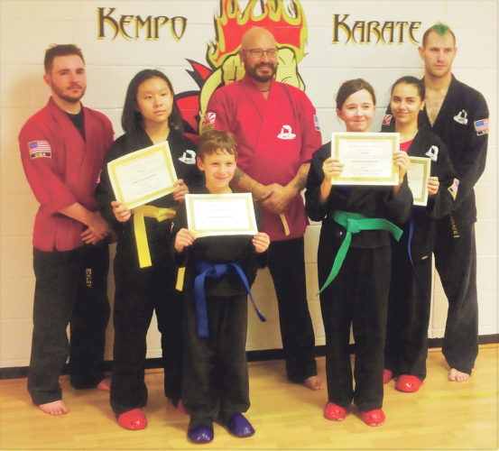 Submitted Photo The Family Martial Arts Center and the Kempo Karate Organization recently held a belt promotion ceremony. Pictured from left are Sensei Jake Eckley, Kohai Sally Chen, Kohai Cameron Ninja Matteson, Master Sensei Bill Matteson, Sempei Gwen Skelly, Kohai Alex Cornell and Sensei Don LeBlanc.
