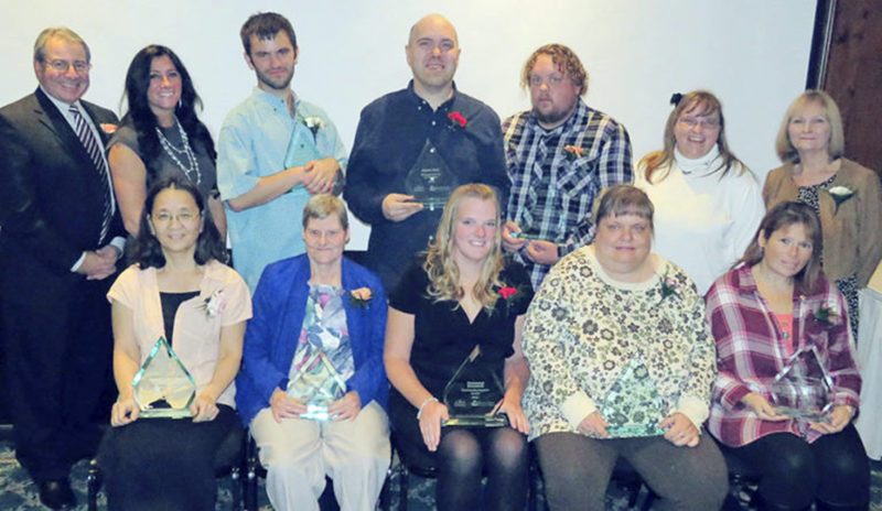 Submitted Photo Recipients of the Disability Awareness Awards pose together. Pictured from left are, sitting, Ke-Khee Greenough, Mental Health Award; Sandra Clark, the Volunteer of the Year; Kelly Sullivan of Fastenal, Community Support Award; Sharon Buesink, Advocate of the Year; and Rhonda Scott, Community Service Award; and, standing, Thomas Whitney and Velvet Lisa of Southern Tier Meadows, the Employer of the Year; Tyler Shaw, Outstanding Achievement Award; Chris Riel, the Success of the Year; Gregory Slagle, NYSID Outstanding Performer; and Deanna DeGolier and Debbie Spinner from Southern Tier Meadows. Missing from the photo is Willow Taft, Health Provider of the Year.