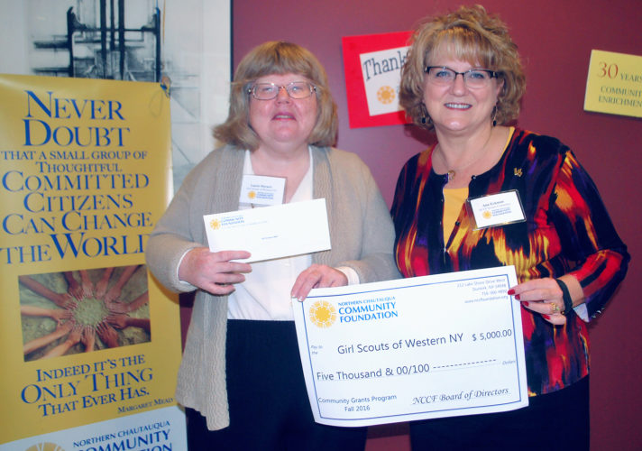 Submitted Photo Girl Scouts of Western New York staff member Laurie Marucci (left) and Northern Chautauqua Community Foundation grants committee member Ann Eckman are seen with the donation check of $5,000 to the GSWNY from NCCF.