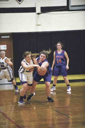 OBSERVER Photos by Roger Coda At left, Pine Valley's Emily Raiport, left, and Cassadaga Valley's Paige Hitchcock, right, battle for a loose ball in the first game of the Hae Jude Tip-Off basketball tournament. At right, Forestville's Phoebe Kingsfield, left, and teammate Ashlee Bailey, right, trap Silver Creek's Carley Pawlak in the second game of the tournament.