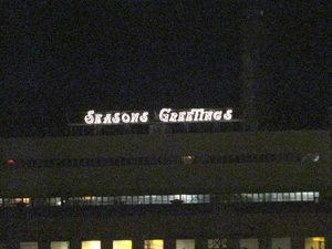 OBSERVER Photo by Greg Fox This merry sign perched atop NRG Energy's Dunkirk power plant greets people across the Dunkirk Harbor. The message is a welcome sight for many, as the plant's repowering project may finally be back on track — just in time for Christmas.