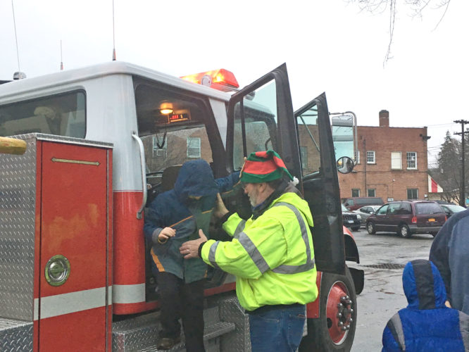 OBSERVER Photo by Andrew David Kuczkowski Christmas in Gowanda had many attractions, including fire truck and police car rides. Community members got a closer look at who is overseeing them.