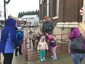 OBSERVER Photo by Andrew Kuczkowski Christmas in Gowanda on Saturday had family-friendly events for all. One draw was the reindeer that stood outside of Persia Town Hall in the epicenter of its downtown.