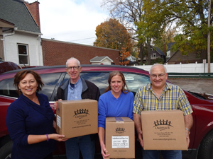 Submitted Photo Westfield-Mayville Rotary Club Members (left to right) Sue Hammond, Jim Wakeman, Adele Harrington and Mike Harrington recently delivered 108 packages of fortified macaroni and cheese dinners to local food pantries. Each package provides six nutritionally balanced meals. This Rotary Club funded $150 worth of meals through The Outreach Program. These Rotarians and others assembled hundreds of meals on Oct. 22 as part of the Rotary District 7090 Conference in Batavia.