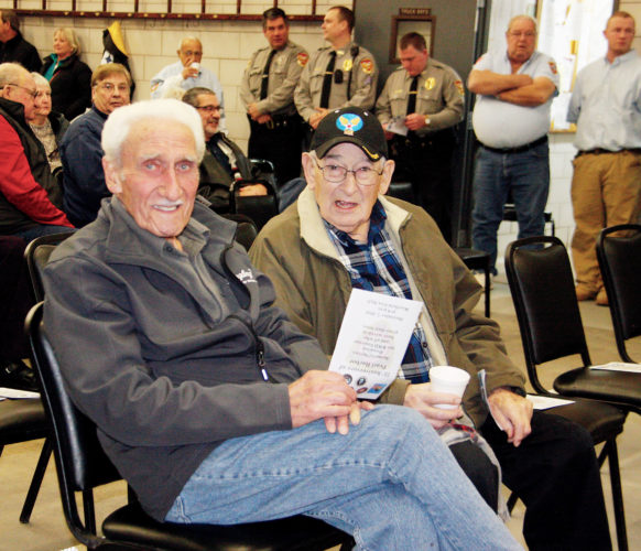 OBSERVER Photo by Tonja Dodd Dominic Rosotto and Cedio Gizzi reflect on Pearl Harbor Day, both men were veterans in World War II and were honored by the local community at the Westfield Fire Hall, Wednesday, December 7, 2016.